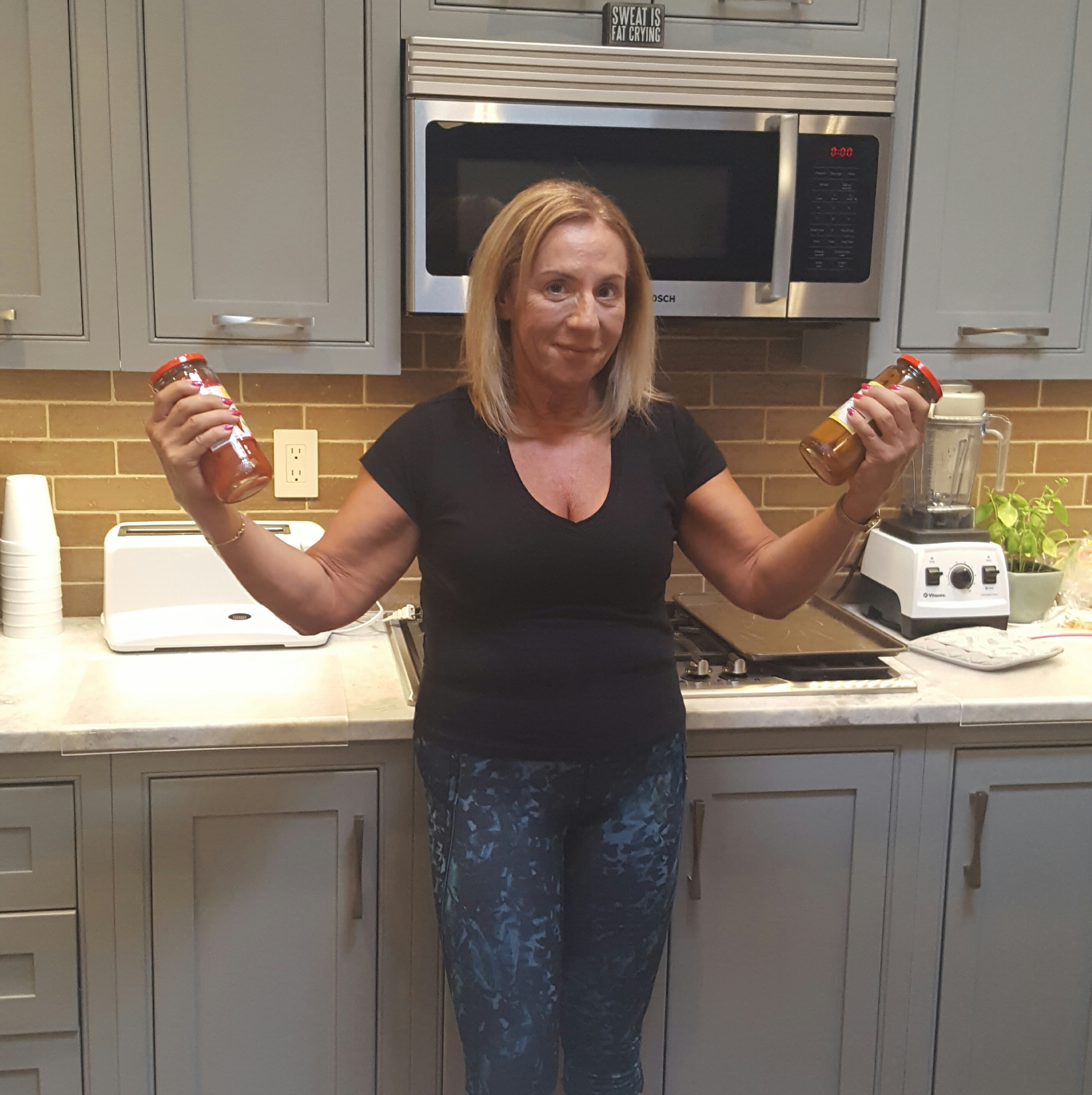 follow-phyllis-7 sneaky ways to get exercise into your day - biceps in kitchen